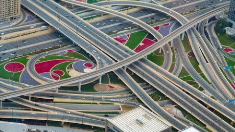 above view of bridges and roads crossing each other