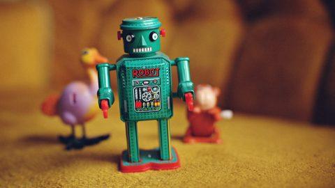 green metal toy robot