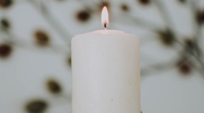 Lit white candle