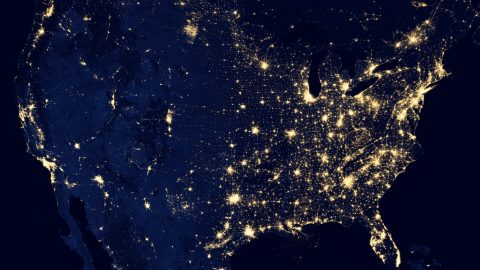 aerial photo of the world at night lit up