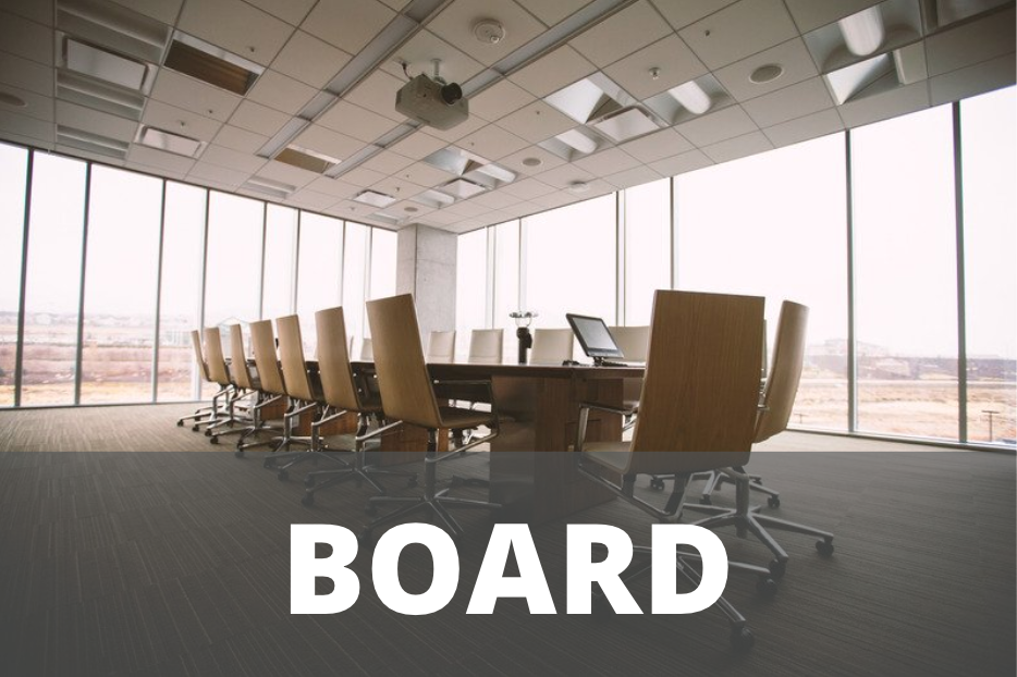 """Boardroom table and chairs covered with the word """"board"""""""