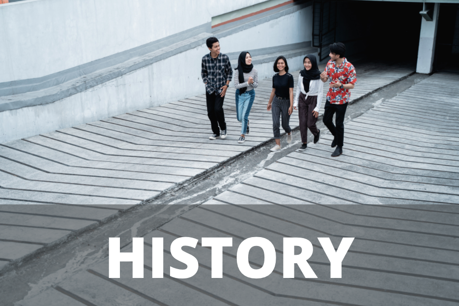 five diverse people walking up a concrete ramp with the wo