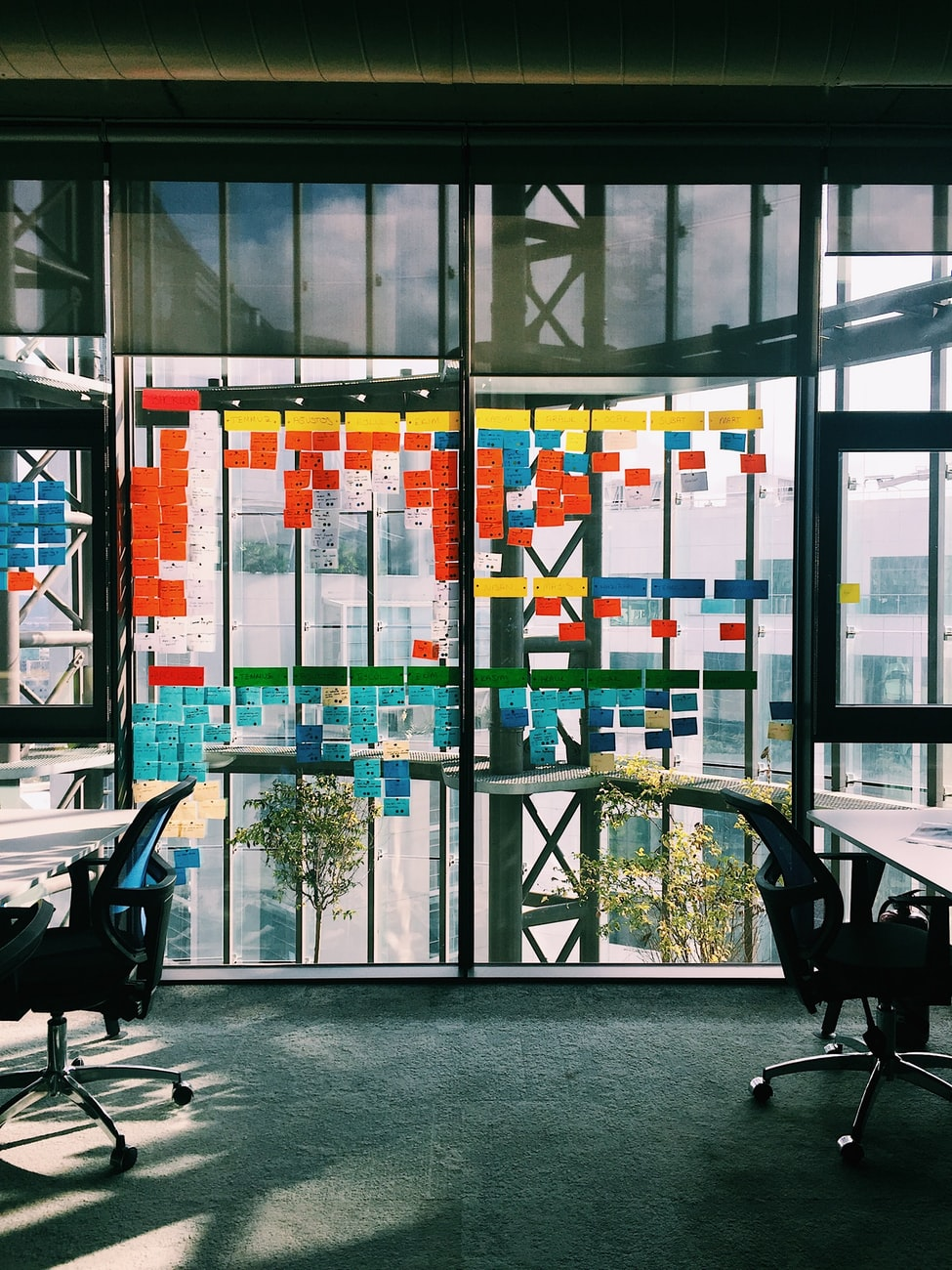 post it notes covering office windows