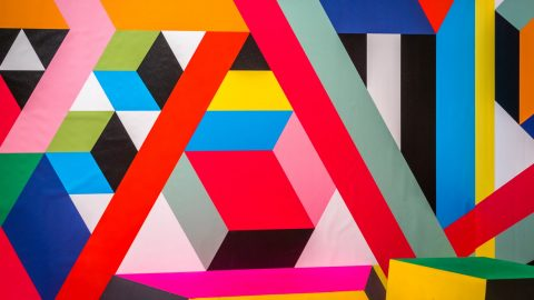 A wall mural of colourful colliding lines
