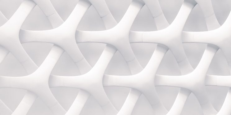 a textured pattern of white interlocking spokes