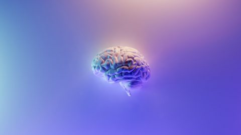 Artwork of a glowing brain on a purple gradient background