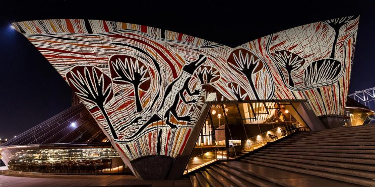 The sydney opera house with indigenous art projected onto it
