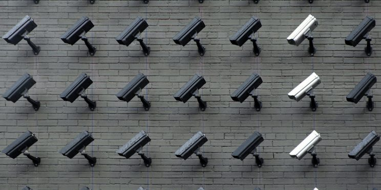 A wall full of security cameras all pointing in the same direction